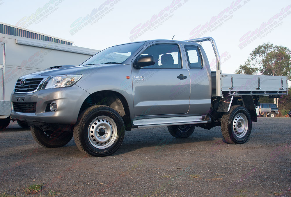 Front side angle view of Hilux with 2 Inch Profender Monotube Remote Res lift kit