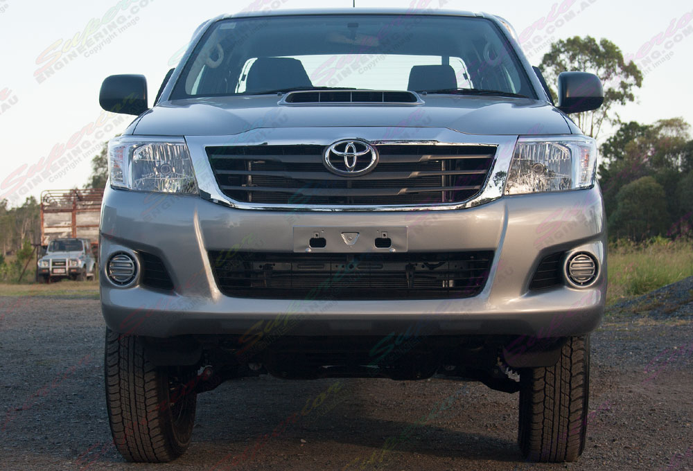 Front on view of Toyota Hilux with 2 Inch Profender Monotube Remote Res lift kit