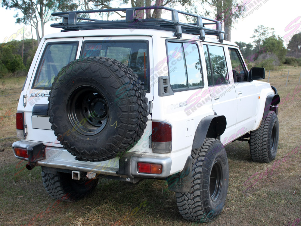 Rear side view of a Nissan Patrol with 5 inch Profender Superflex suspension kit fitted