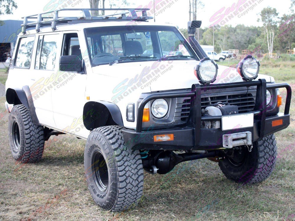 Right side view of a Patrol fitted out with 5 inch Profender Superflex lift kit