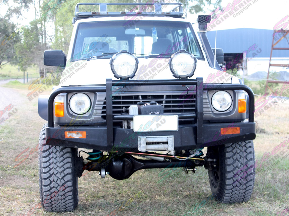 High front view of a Nissan Patrol fitted out with 5 inch Profender Superflex lift kit