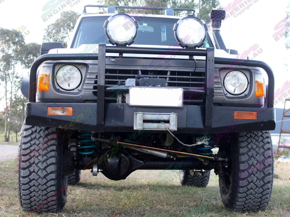 Low front view of a Nissan Patrol with 5 inch Profender Superflex suspension kit fitted