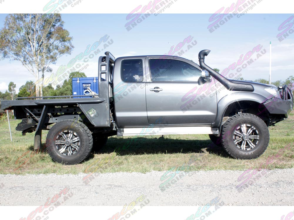 "Side view of Toyota Hilux fitted with 5"" Superior Profender lift kit"