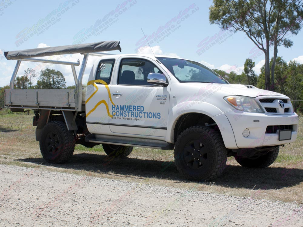 Right side view of Toyota Hilux IFS fitted with a 4 Inch Profender Nitro Gas Lift Kit