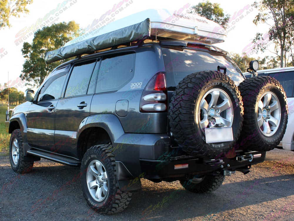 Rear side left view of a Prado 120 fitted with 3 inch Profender Mono-tube Remote Res struts and shocks