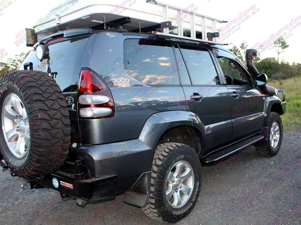 Rear side right view of a Prado 120 fitted with 3 inch Profender Mono-tube Remote Res struts and shocks