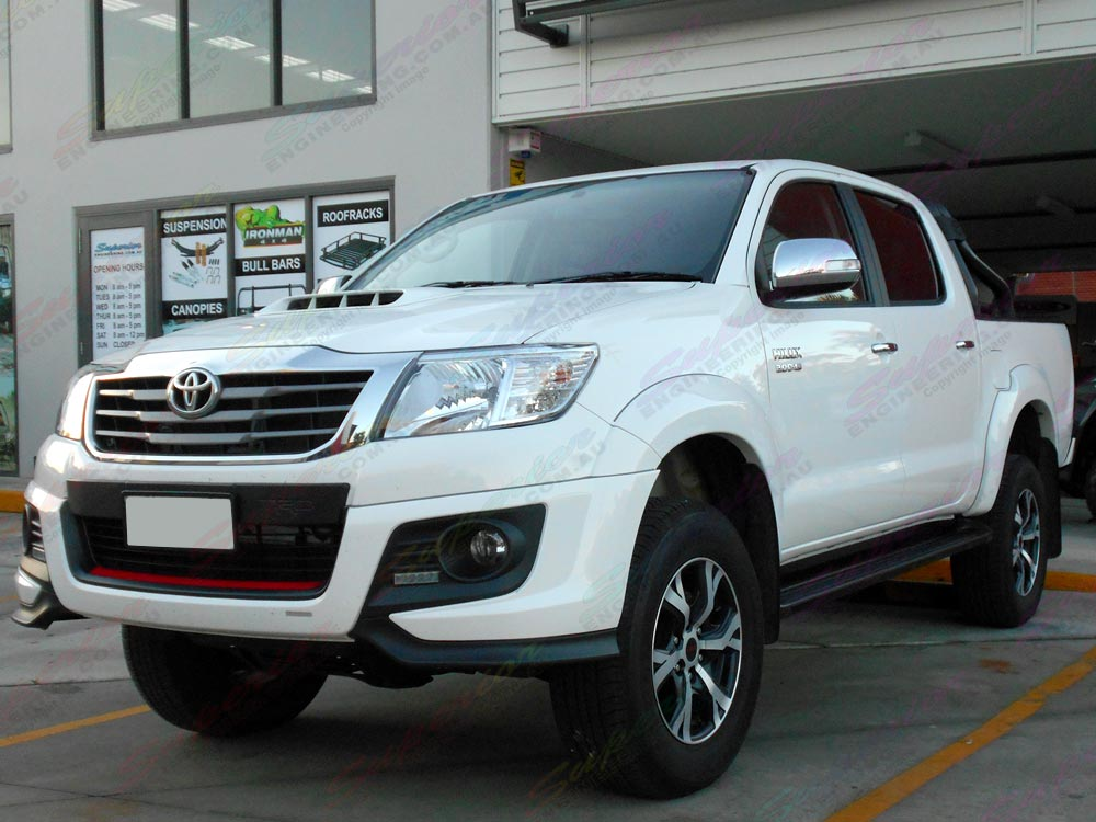 Front side angle view of a Toyota Hilux dual cab fitted with a 3 Inch Profender Lift Kit Stage 2