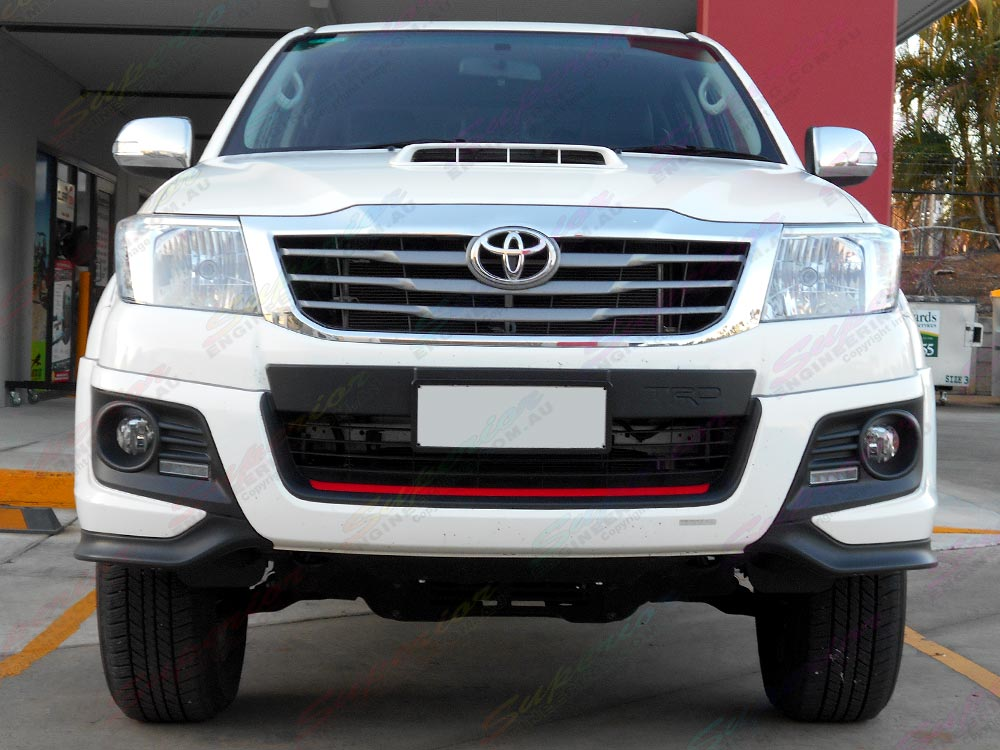 Front view of a Toyota Hilux with a 3 Inch Profender Lift Kit Stage 2
