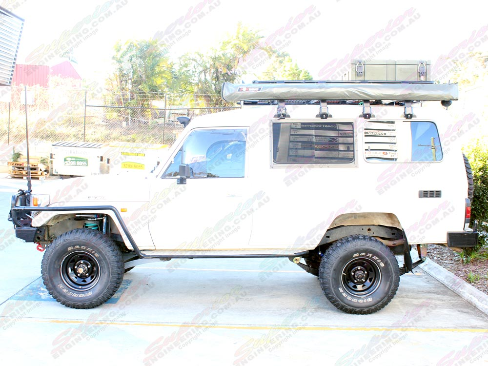 Left side profile view of the Toyota Landcruiser 78 Series troop carrier fitted with the 3 inch lift kit
