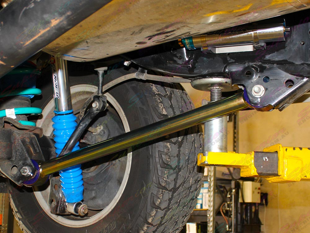 Closeup view of a heavy duty fixed Superior rear lower control arm fitted to a current model 200 Series Toyota Landcruiser 4WD